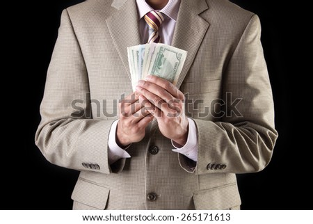 Corporate business man showing and counting money, american dollars  - stock photo