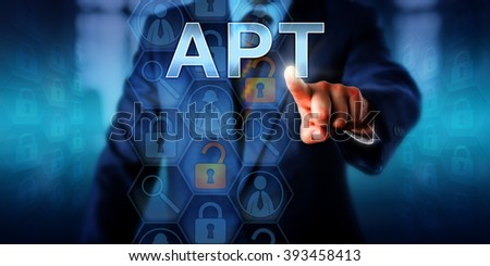 Corporate cyber crime victim touching APT on a virtual screen. Information technology and computer security concept for Advanced Persistent Attack which is an ongoing hacking process or cyber threat. - stock photo