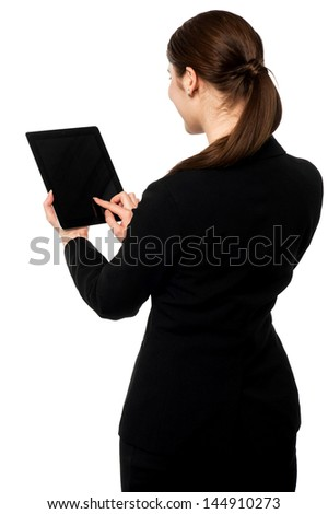 Corporate lady browsing on her tablet pc - stock photo