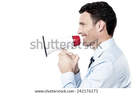 Corporate man making announcement with loudhailer - stock photo