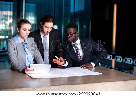 Corporate people discussing their next project - stock photo