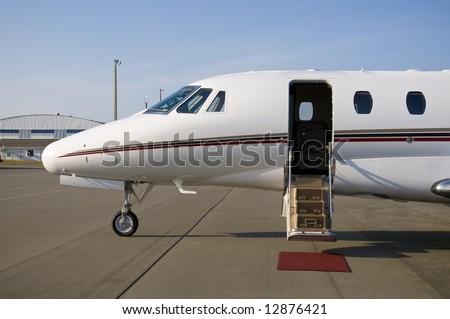 Corporate private luxury jet at airport door open - stock photo