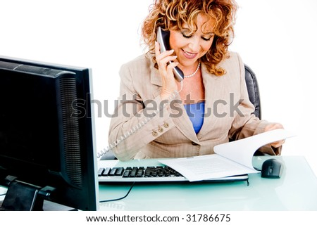 Corporate woman busy Looking at file work and attending call - stock photo