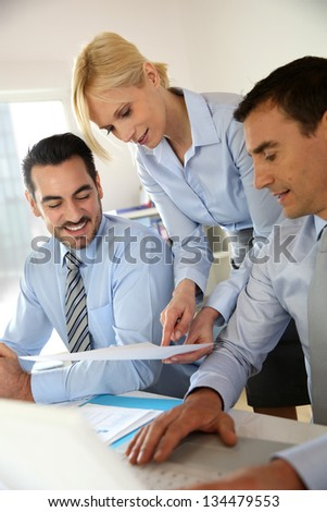 Corporate woman presenting results to sales team - stock photo