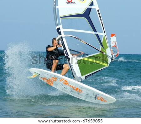 CORRALEJO, FUERTEVENTURA, SPAIN - AUGUST 18: Windsurfer Maurin Rottenwalter making extreme trick on a flat water on August 18, 2010 in Fuerteventura, Canary islands, Spain - stock photo