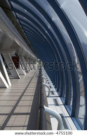 Corridor in a modern glass brigde - stock photo