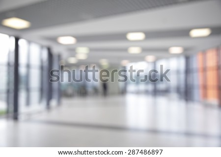 Corridor in airport out of focus - stock photo