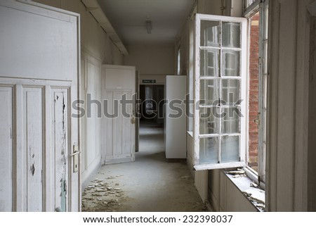 corridor in old abandoned hospital in Germany  - stock photo