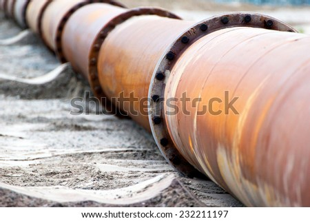 Corroded pipeline, used for land reclamation, on a beach. Holland - stock photo