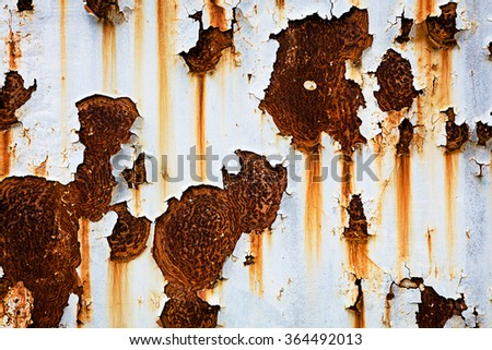 Corroded white metal background. Rusted white painted metal wall. Rusty metal background with streaks of rust. Rust stains. The metal surface rusted spots. Rysty corrosion. - stock photo