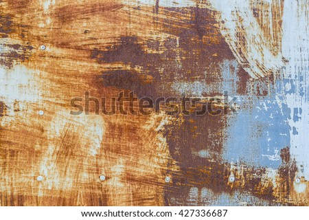 Corroded white metal background. Rusted white painted metal wall. Rusty metal background with streaks of rust. Rust stains. The metal surface rusted spots. rust corrosion. - stock photo