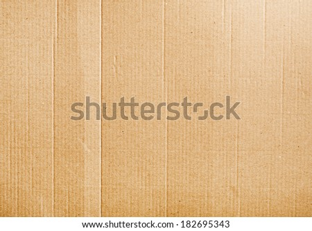 Corrugated cardboard background texture with some wrinkles  - stock photo