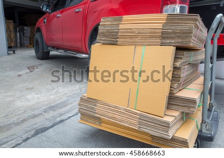 corrugated cardboard boxes tied with nylon rope ready to deliver - stock photo
