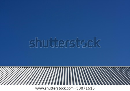 Corrugated Metal Roof against Blue Sky - stock photo
