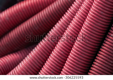 Corrugated pipes at a construction site - stock photo