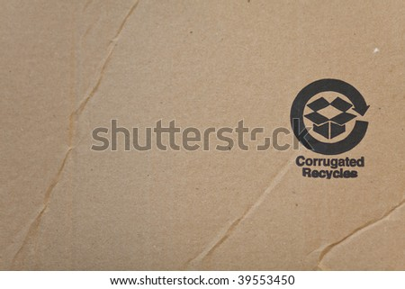 Corrugated recycled carton with black imprint - stock photo