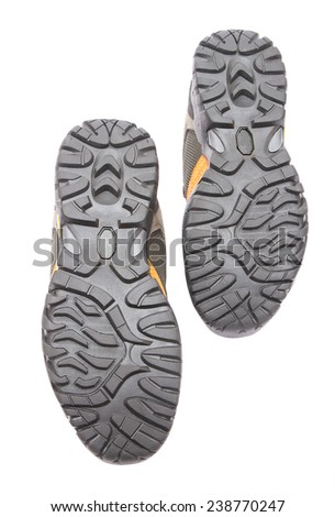 Corrugated sole of sports boots on a white background - stock photo