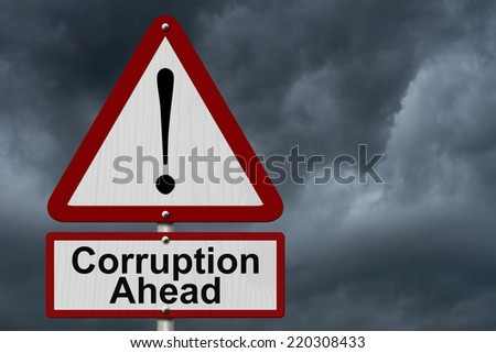 Corruption Ahead Caution Sign, Red and White Triangle Caution sign with words Corruption Ahead with stormy sky - stock photo