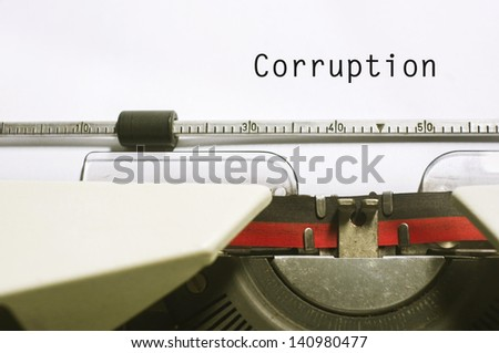 corruption concepts, with message on typewriter paper. - stock photo