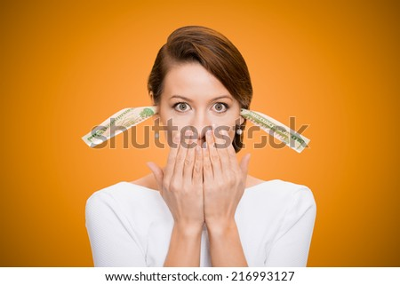 Corruption. It will keep me quiet. Bribery concept in politics, business, diplomacy. Corporate businesswoman plugs her ears with dollar banknotes, bills, covers her mouth, isolated orange background  - stock photo