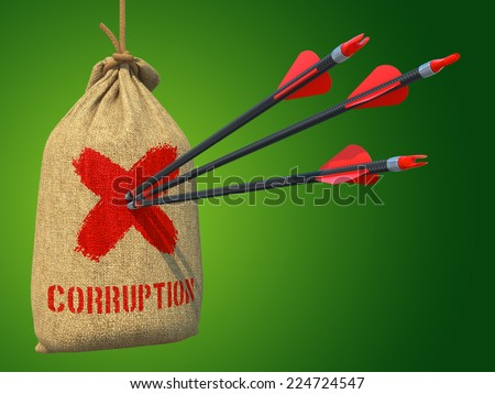 Corruption - Three Arrows Hit in Red Target on a Hanging Sack on Green Background. - stock photo