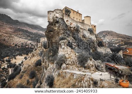 Corte - impressive medieval town in Corsica, artistic toned pict - stock photo