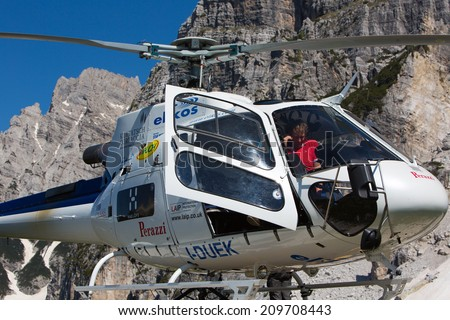CORTINA D'AMPEZZO, ITALY - JUNE 08: Mountain rescue helicopter in the italian Alps. June 08, 2013 in Cortina d'Ampezzo, Italy. - stock photo