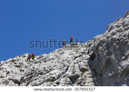 CORTINA D'AMPEZZO, ITALY, June 08: Mountain rescue team members in action in the mountains of Dolomites also known as the Soccorso Alpino - June 8th 2014 in Italy. - stock photo