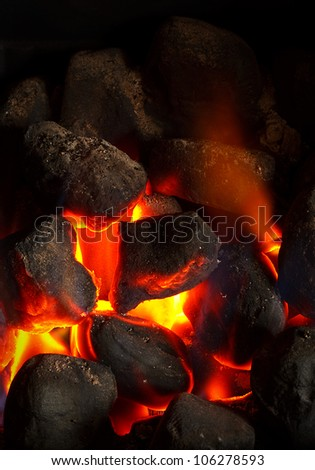 Cose up of an imitation solid fuel fire powered by mains gas supply - stock photo