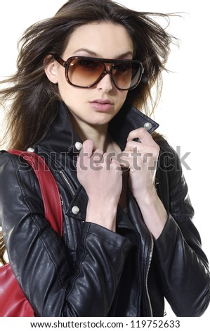 Cose up young girl in sunglasses with handbag - stock photo
