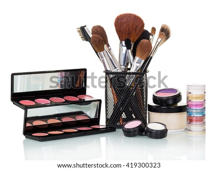 Cosmetic brush, eye shadow, blush and lip gloss isolated on white background. - stock photo