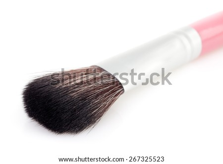 cosmetic brush on a white background - stock photo