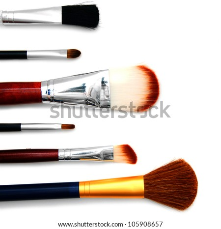 Cosmetic brushes. On a white background. - stock photo
