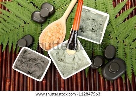 cosmetic clay for spa treatments on bamboo background close-up - stock photo