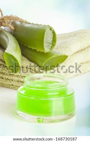 Cosmetic cream and aloe vera on the green towel  - stock photo