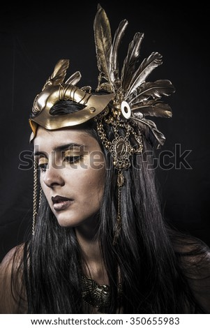 Cosmetic, ensual young woman with golden mask jewelry - stock photo