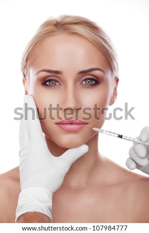 Cosmetic injection to the pretty woman face - stock photo