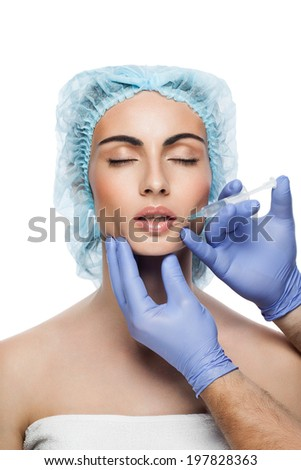 Cosmetic injection to the pretty woman face on white background - stock photo