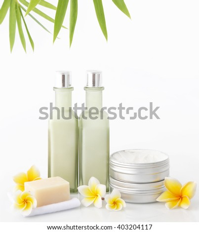 Cosmetic products on the white background with bamboo leaves - stock photo