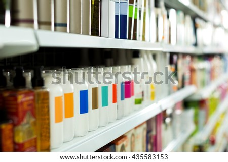 Cosmetic section with conditioners, shampoo and hair treatment in store - stock photo