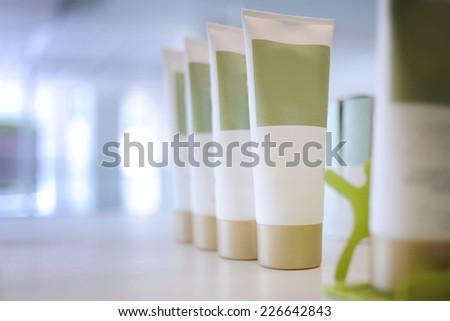 cosmetic tube on the shelf - stock photo