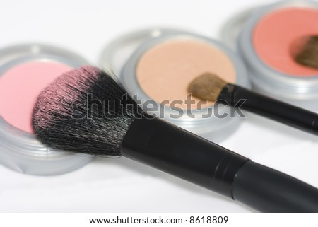 Cosmetics and brushes isolated on white background - stock photo