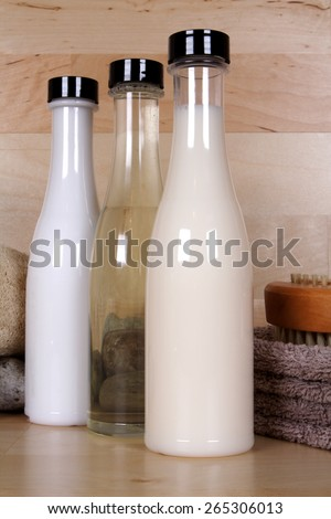 Cosmetics bottles in spa setting - stock photo