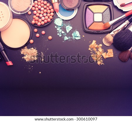 Cosmetics make-up on black background. Top view mock up. - stock photo