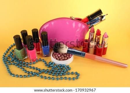 cosmetics on yellow background - stock photo