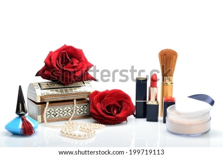 Cosmetics, perfumes, pearl beads, jewelry box and roses in a still life - stock photo