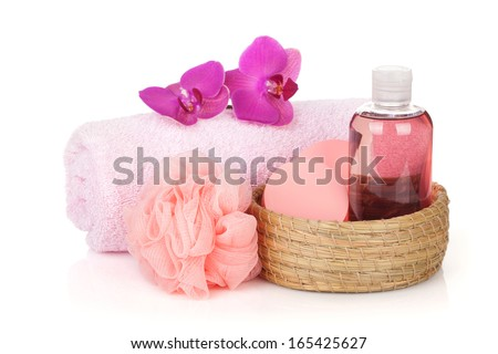 Cosmetics, towel and orchid flowers. Isolated on white background - stock photo