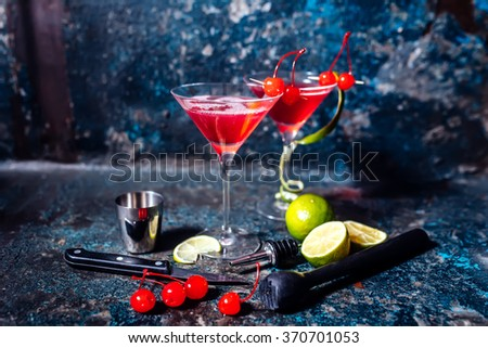 cosmopolitan cherry martini cocktail, served cold with lime and ice - stock photo