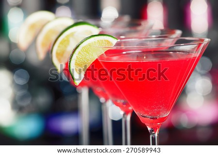 Cosmopolitan cocktail shot on a bar counter in a nightclub - stock photo