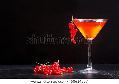 cosmopolitan cocktail with red currant on dark background - stock photo
